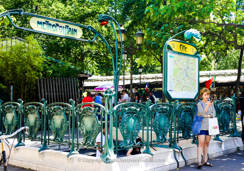 Cité Metro station entrance by Hector Guimard next to the Flower Market