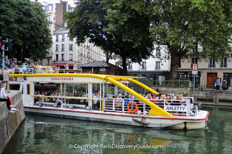 Cruise boat in Canal Saint-Martin as it heads toward Bassin de la Villette