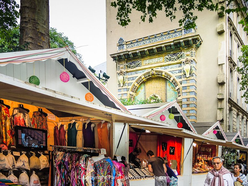 Chalets at the Saint-Germain-des Prés Christmas Market selling high-quality wool and cashmere scarves and hand-crafted jewelry