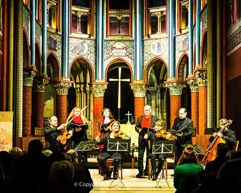 Musicians playing Christmas concert at EgliseSaint Germain des Prés