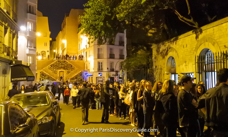Crowd waiting in line for the 5th arrondissement's Bal des Pompiers held in Arènes de Lutèce
