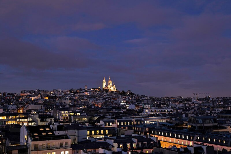 View of Sacre Coeur from the rooftop terrace at Galeries Lafayette - Photo credit: istockphotos.com/Maria Gribova