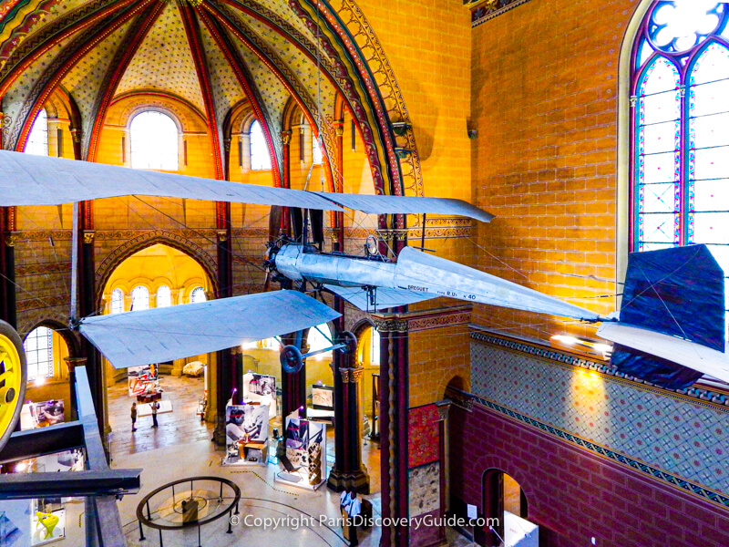 Early flying machine hanging from the ceiling in Museum of Arts and Crafts in Paris