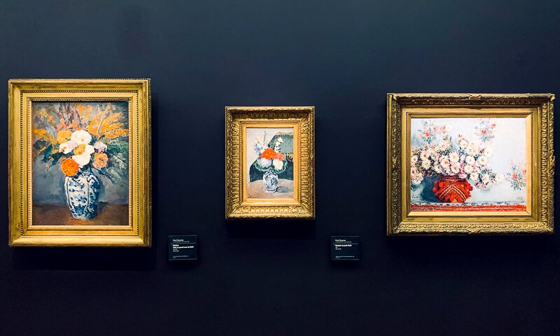 Stilllifes of flowers in vases painted by Cezanne (the two on the left) and Monet (right)