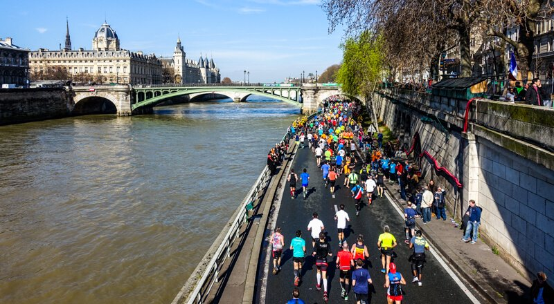 Paris Marathon runners along the Seine River