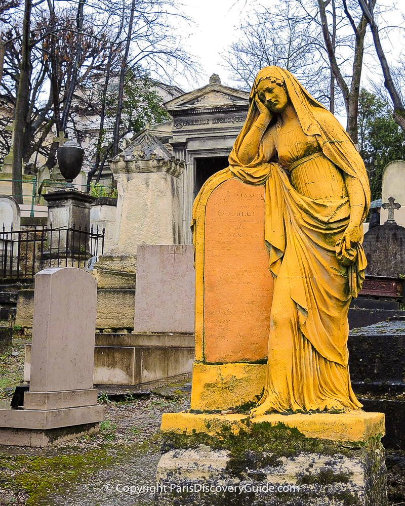 Gold-painted statue of the grieving widow of Louis-Sébastien Gourlot in Pere Lachaise Cemetery in Paris