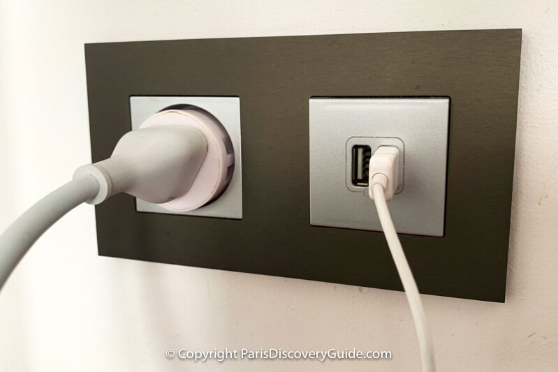 Type E socket (with an adapter and plug in it) and USB port combination outlet
