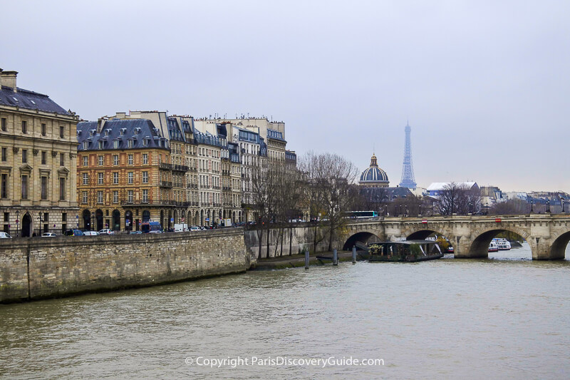 Skyline view of Paris's Right Bank, the Pont Neuf bridge, Institut de France, and the Eiffel Tower