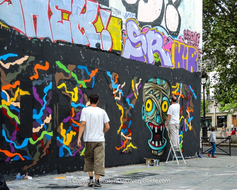Street Artists creating a giant mural across from Canal Saint Martin