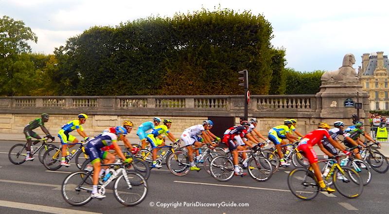 Tour de France competitors racing around the Tuileries Garden in Paris - Top July Event