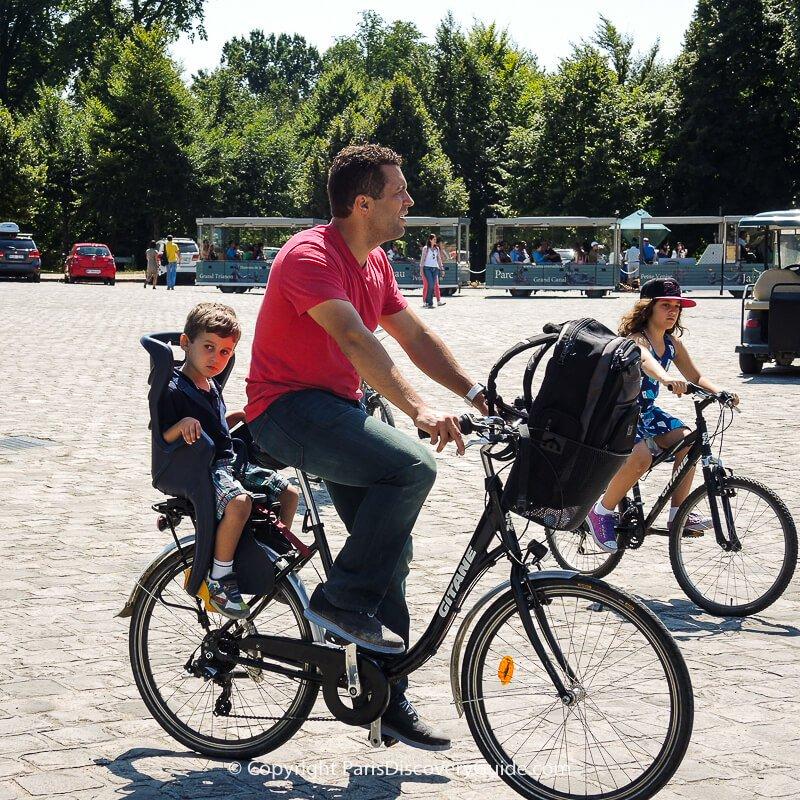 Bikers on Palace of Versailles Estate near Paris