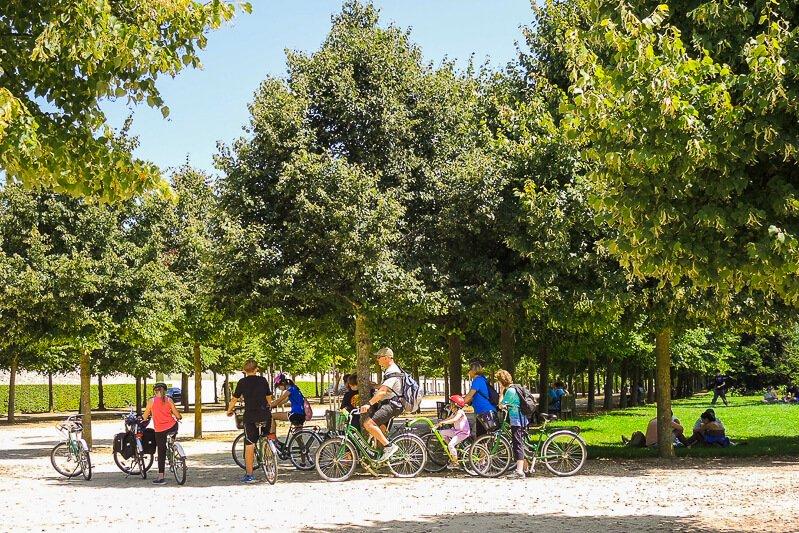 Bike tour exploring trails through the woods at Chateau de Versailles