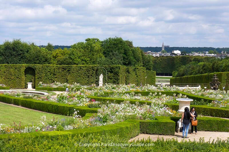 Formal garden at Versailles, with distant view of town of Versailles