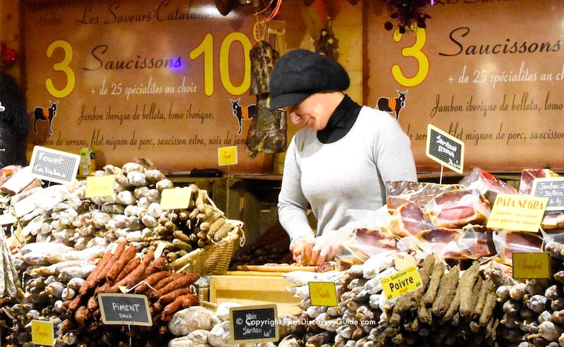 Paris Christmas Markets along Champs Elysees - sausages from Southwestern France