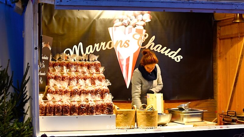 Paris Christmas Market at Saint-Germain-des-Pres - hot roasted chestnuts