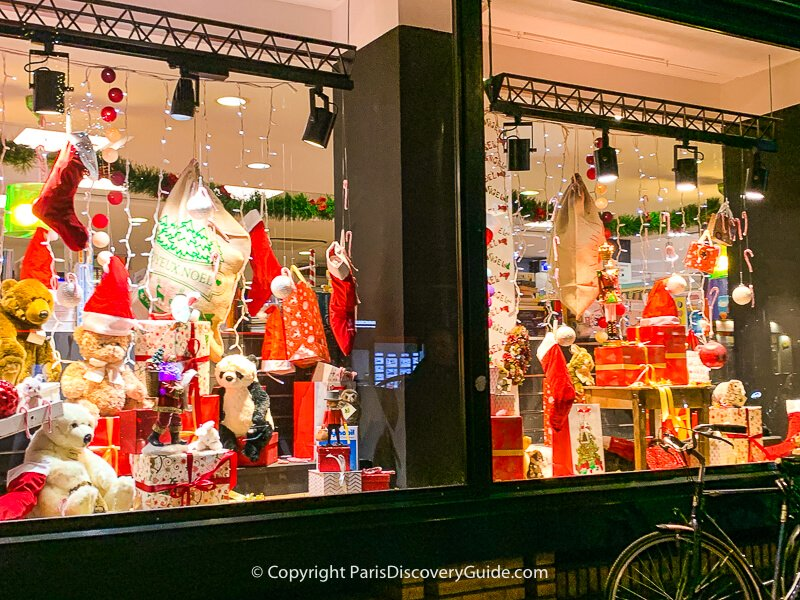 Toys and Christmas stockings in this holiday window display on Boulevard Saint-Germain