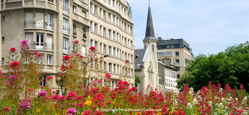 Flowers blooming in a public square in the Batignolles neighborhood in Paris's 17th Arrondissement