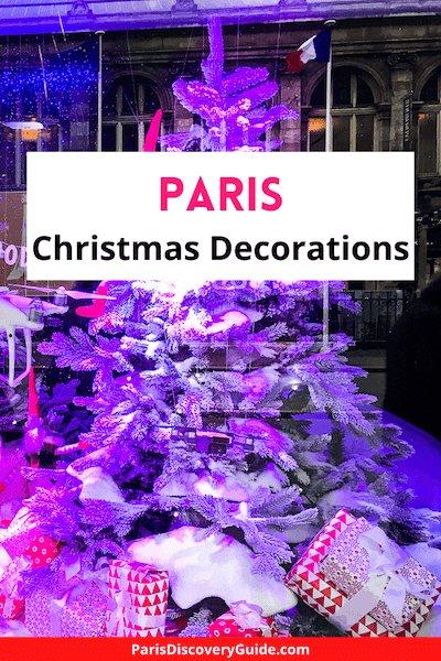 Christmas tree display in store window at BHV department store in Le Marais neighborhood in Paris
