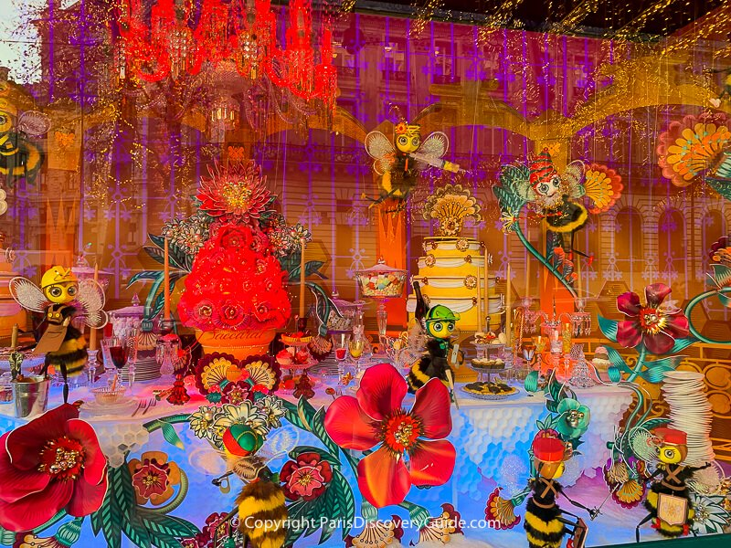 Bees prepare for the holidays in a magical world of brilliant flowers- part of a multi-window scene at Galeries Lafayette